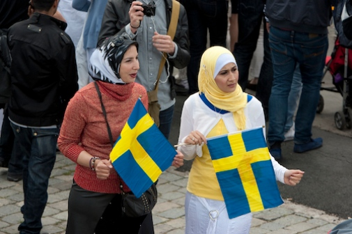 Immigrants with Swedish flag Photo: Folmer © 2013 Mostphotos